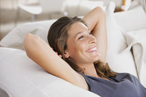 woman relaxing with air conditioner well serviced